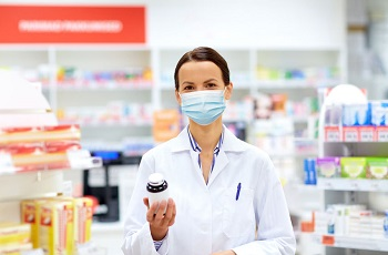 Pharmacist wears a face mask